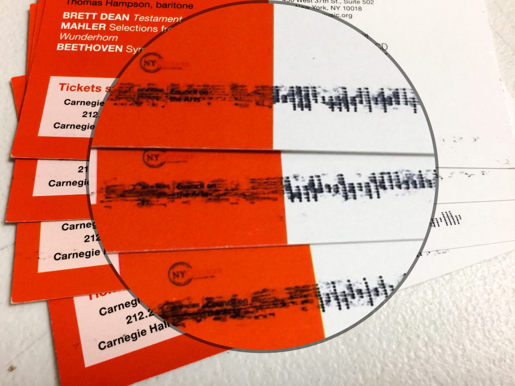 Smeared barcode on postcard